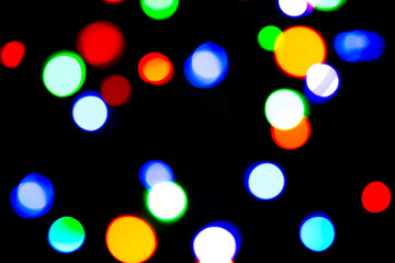 Blurred background with colorful bokeh lights on dark background/blurred Christmas lights