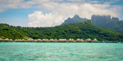 Bora Bora panorama landscape with overwater bungalows resort. Tropical island in the sea.