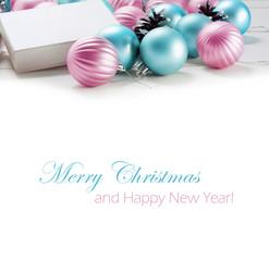 Beautiful gift box and blue and pink Christmas balls