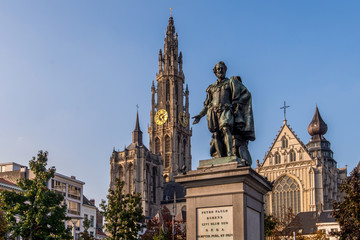 Statue of Pieter Paul Rubens with the Cathedral of our Lady in the background in Antwerp, Belgium