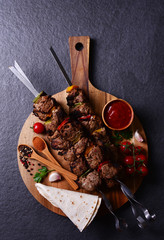 Shish kebab with spices and vegetables