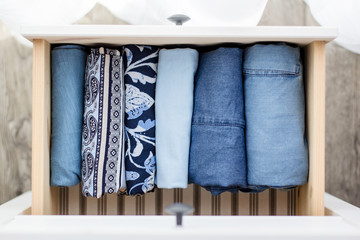 women's clothing blue folded in a chest of drawers