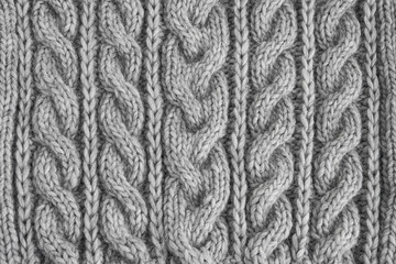 Gray knitted texture. Handmade Knitwear. Background