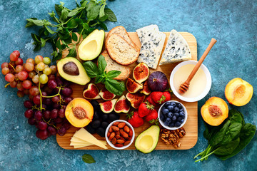 Assorted healthy cheese and fruits light snack