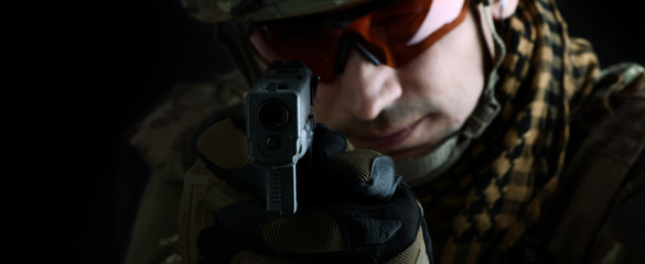 aiming at the camera focus on the muzzle of gun