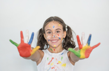 little girl smeared with paints