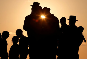 Jewish worshippers take part in the Tashlich ritual on the shore of the Mediterranean Sea, ahead of Yom Kippur, the Jewish Day of Atonement in Herzliya