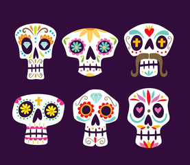 Colorful mexican skull collection. Cute cartoon sugar skulls isolated on purple background. Set 1 of 2. Vector illustration.