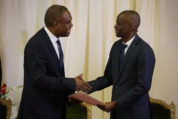 Haiti's PM Ceant shakes hands with President Moise during the inauguration ceremony at the National Palace in Port-au-Prince