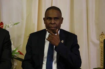 Haiti's PM Ceant touches his face during the inauguration ceremony at the National Palace in Port-au-Prince