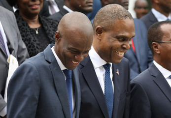 Haiti's President Moise and PM Ceant laugh as they pose for a picture with members of the Government in the gardens of the National Palace during the inauguration ceremony in Port-au-Prince