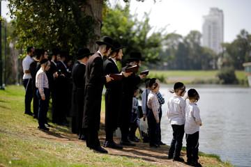 Ultra-Orthodox Jews perform the Tashlich ritual ahead of Yom Kippur in Ramat Gan, Israel