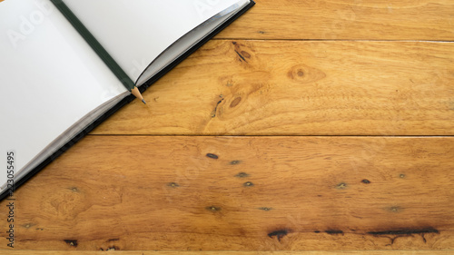 Wall mural Office desk table pencil with notebook copyspace on wood background