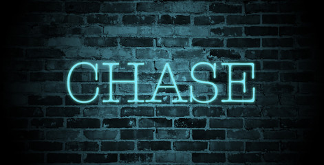 first name chase in blue neon on brick wall