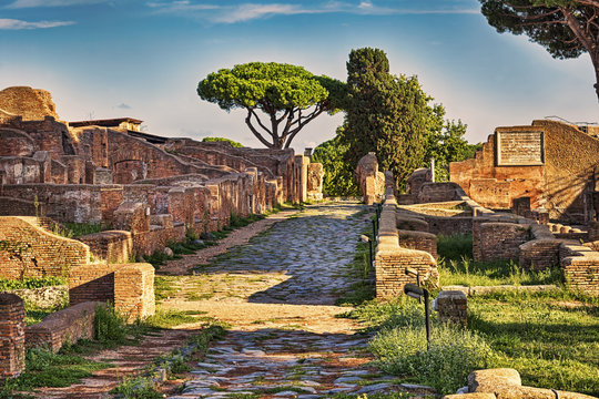 Archaeological Roman empire street view in Ostia antica, a beautiful travel destination with well preserved ruins in Rome - Italy