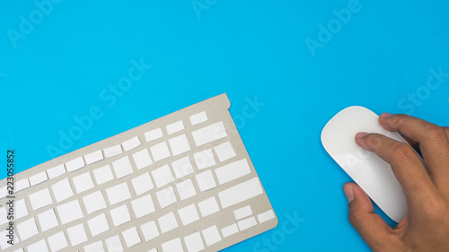 Poster Office desk table Top view with keyboard paper cut and hand  blue background