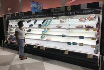 A customer looks on at a Harris Teeter grocery store that reopened today in Wilmington