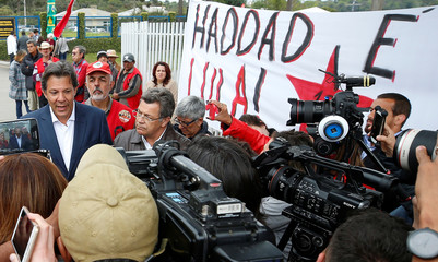 Workers Party presidential candidate Haddad speaks to journalists in front of the Federal Police headquarters, where Brazilian former President Luiz Inacio Lula da Silva is imprisoned, after visiting him in Curitiba