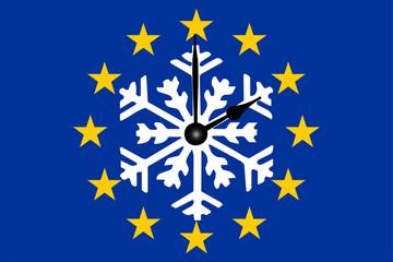 Europa Zeitumstellung Europaflagge mit Schneeflocke und Zeiger
