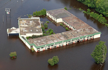 Building sits in floodwater caused by Hurricane Florence, in this aerial picture, in Lumberton