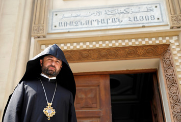 Bishop Ashot Mnatsakanyan, Prelate of the Armenian Diocese in Egypt looks on after an interview with Reuters during a Sunday mass in the Armenian Orthodox Church in Cairo