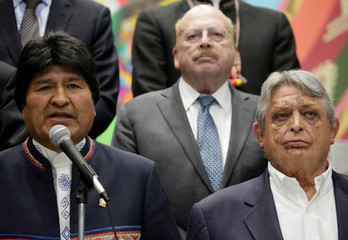 Bolivia's President Evo Morales  former President Jaime Paz Zamora  and former Foreign Minister Carlos Iturralde attend a news conference after a meeting at the presidential palace La Casa Grande del Pueblo in La Paz