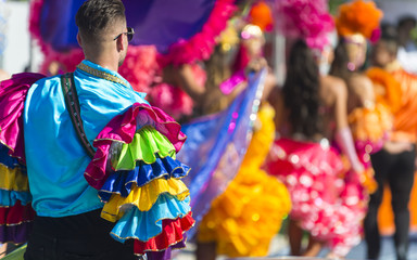 Abstract view of carnival dancers in colorful frilled costumes