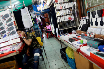 Street vendors sell phone accessories in Khaosan Road in Bangkok