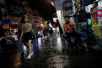 Street vendors sell clothes in Khaosan Road in Bangkok