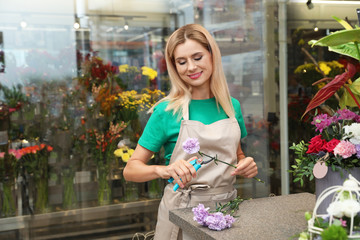 Female florist making beautiful bouquet in flower shop