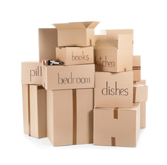 Moving boxes and adhesive tape dispenser on white background