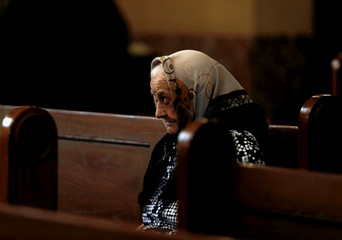 An Armenian Christian attends a Sunday mass at the main Armenian Orthodox Church in Cairo