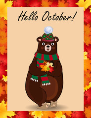 Hello october greeting card with cute bear in hat and scarf holding fallen leaves
