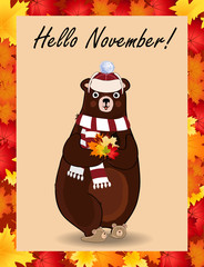 Hello november greeting card with cute bear in hat and scarf holding fallen leaves