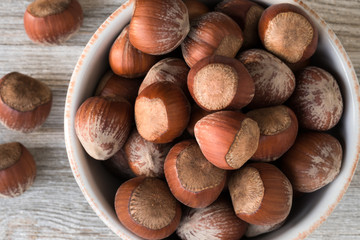 hazelnuts in a white bowl