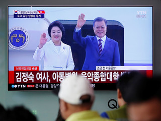 People watch the televised broadcast of South Korea's President Moon Jae-in in Seoul