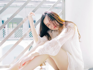 Beautiful Chinese girl sit on floor in sunny days, portrait of romantic young female looking at camera with sexy expression.