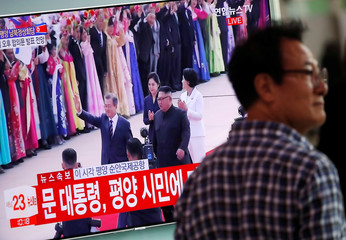 People watch the televised broadcast in Seoul