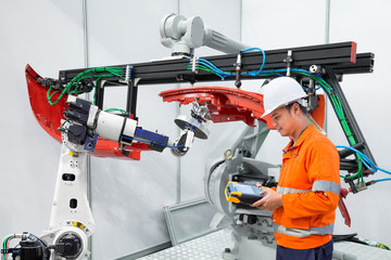 Engineer using measurement tool inspect industrial robot grip automotive workpiece, Smart factory concept
