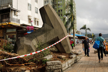 A breakwater is seen being moved onto the pavement after Super Typhoon Mangkhut hit Hong Kong