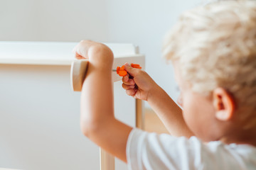 Boy Working On Carpentry At Home