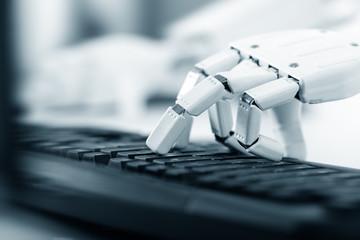Obraz Roboter Hand an einer Tastatur, Prothese, Bionic und Robotik der Zukunft - fototapety do salonu