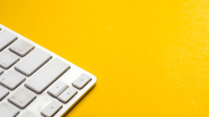 Wall Mural - keyboard close up on yellow background