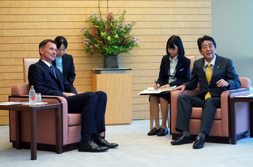 British Foreign Minister Jeremy Hunt and Japanese Prime Minister Shinzo Abe attend a courtesy call at Abe's official residence in Tokyo