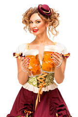 Oktoberfest / Creative concept photo of Oktoberfest waitress wearing a traditional Bavarian costume with beer isolated on white background.