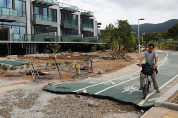 A damaged bicycle path is seen after Super Typhoon Mangkhut hit Hong Kong