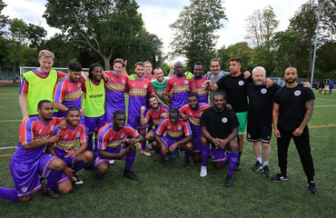 Clapton CFC players pose for pictures after winning their away game against Ealing Town in East Acton, in London