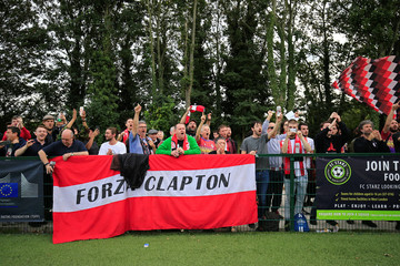 Clapton CFC supporters react after their team won 2-1 in away game against Ealing Town in East Acton, in London, Britain