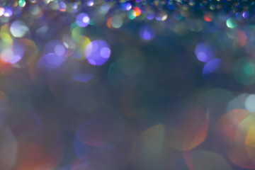 Abstraction colorful bokeh on a dark background. Defocused.