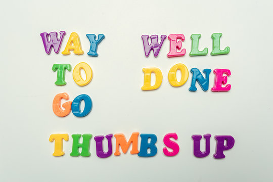 Way to go, Well done, thumbs up words in colorful letters on white background